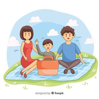 Нарисованная рукой семья имея иллюстрацию пикника