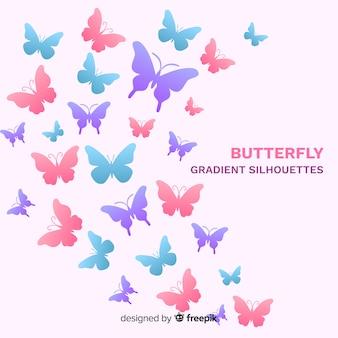 パステルカラーの蝶の背景を飛んで