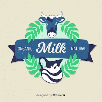 Корова с листьями молока логотип