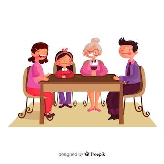 Семья нарисованная рукой сидя вокруг иллюстрации стола