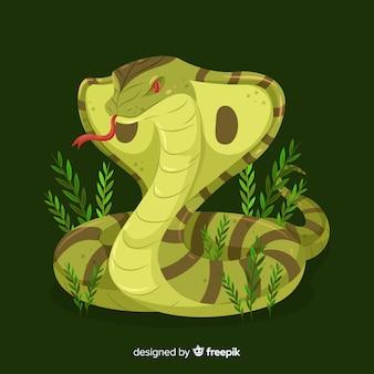 草の背景と手描きコブラ