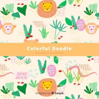 カラフルな落書きジャングルの動物と言葉のパターン