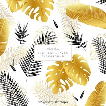黒と金色の熱帯の葉の背景
