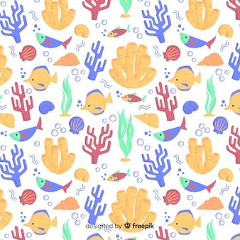 海の動物の背景を持つ手描きサンゴ