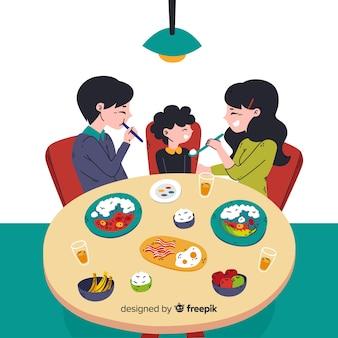 家族のテーブルの周りに座って