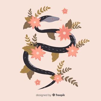 花のイラストが描かれたヘビを手します。
