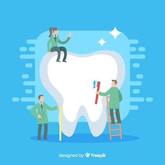 巨大な歯を清掃する歯科医