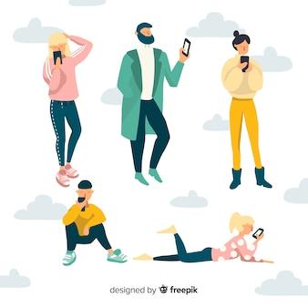 Ручной обращается молодые люди с помощью смартфона