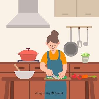 台所で料理をする人