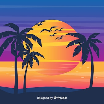 ヤシのシルエットとビーチの夕日