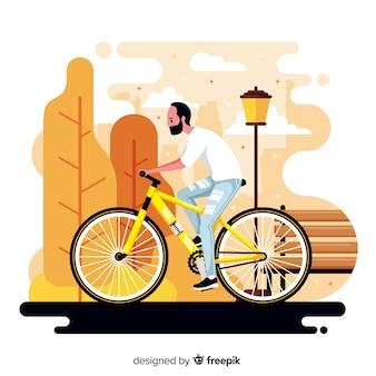 公園のバックグラウンドで自転車に乗る人