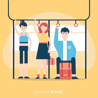 地下鉄で旅行する人々