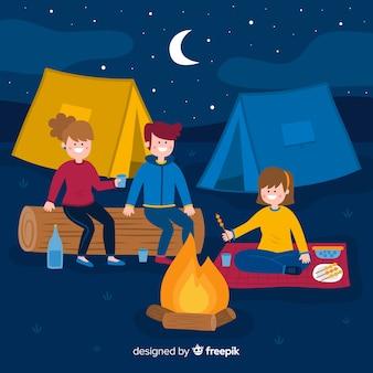 夜にキャンプの人々と背景