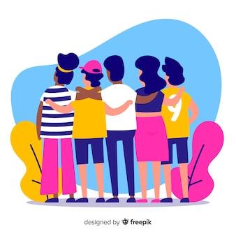 一緒に抱き締める若者のグループ