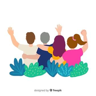 Группа молодых людей обнимаются