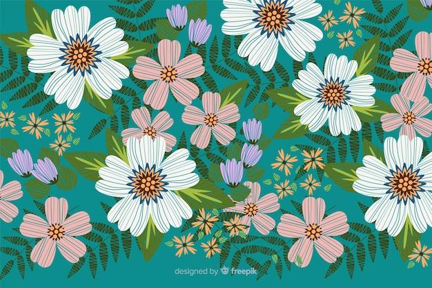 カラフルな装飾的な刺繍花の背景