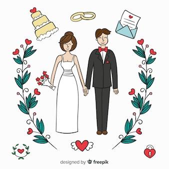 手描きの結婚式のカップルの装飾品