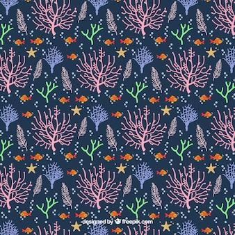 フラットスタイルのサンゴのシームレスなパターンデザイン