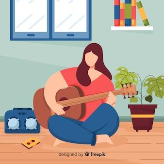 フラット女性、ギターを弾く