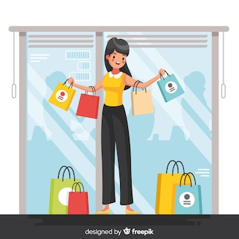 買い物袋を運ぶ幸せな女