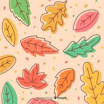 Ручной обращается осенний фон с листьями