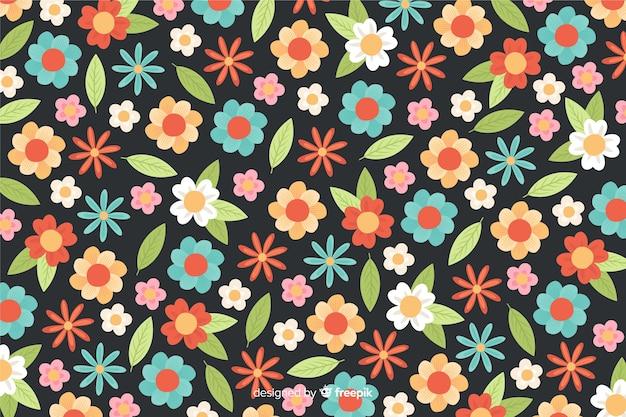花と葉の背景フラットスタイル