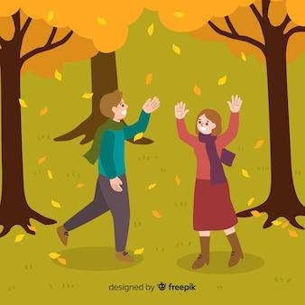 秋の間に公園の人々