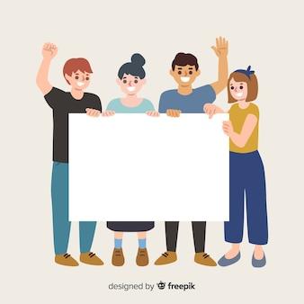 白紙の横断幕を保持している若い人たち