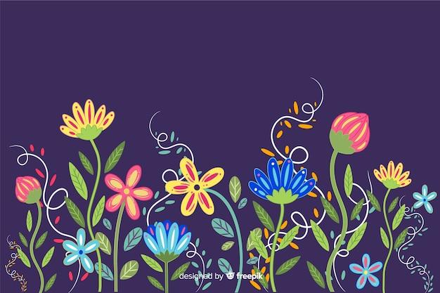 色とりどりの花の背景フラットスタイル