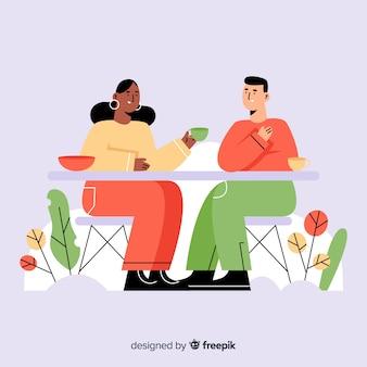 カフェのフラットデザインに座っている人