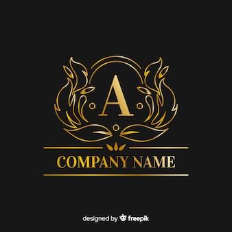 黄金のエレガントな大文字のロゴのテンプレート