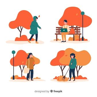秋の公園を歩く人々