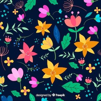 平らなカラフルな花と葉の背景