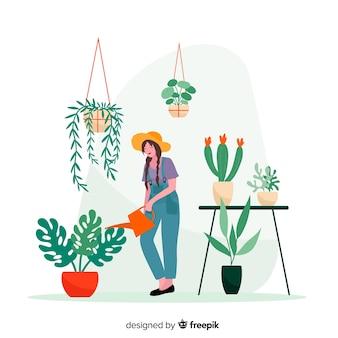 Женщина берет машину е из растений, садовник работает
