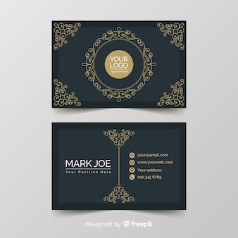 Ручной обращается золотой шаблон визитной карточки