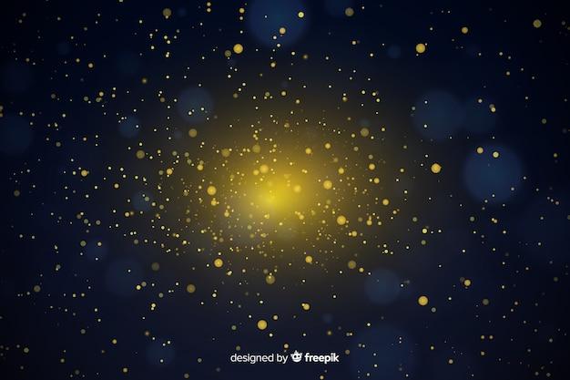 金色の粒子のボケ味を持つ豪華な背景