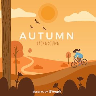 秋の背景に女の子乗馬自転車