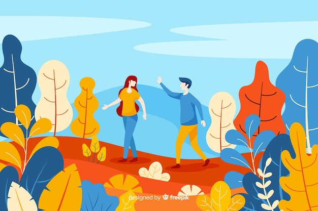 秋の公園の上を歩くカップル