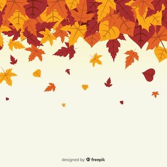 平らな秋の背景の葉