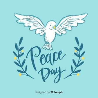 鳩と平和の日の背景をレタリング