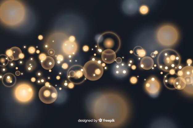 金色の粒子と背景のボケ味