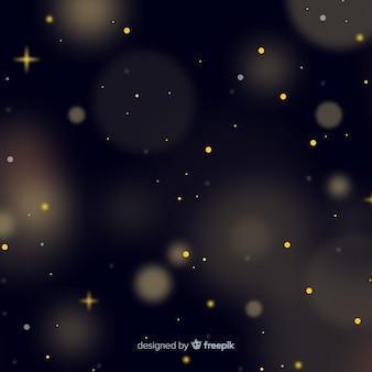 金色の粒子と金色の背景