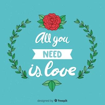 花とロマンチックなレタリングメッセージの背景