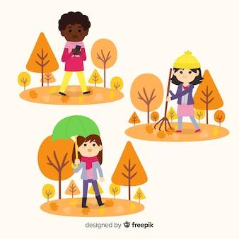 秋の公園を歩いている人