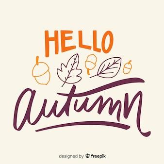 こんにちは、葉と秋のレタリングの背景
