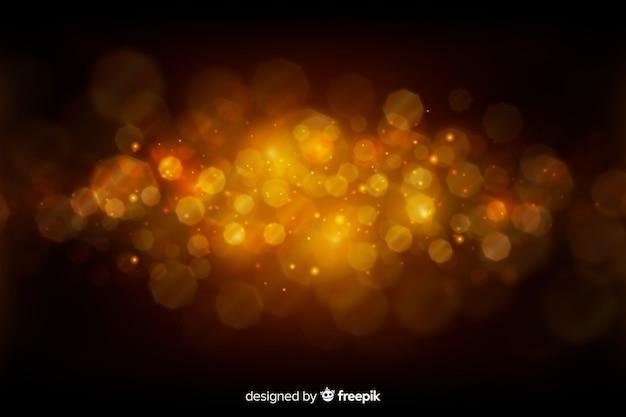 黄金の粒子と豪華な背景
