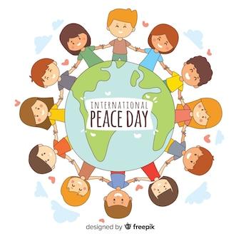 手描きの平和の日の子供たちが手をつないで