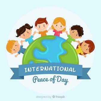 手を繋いでいる子供たちとの平和の日