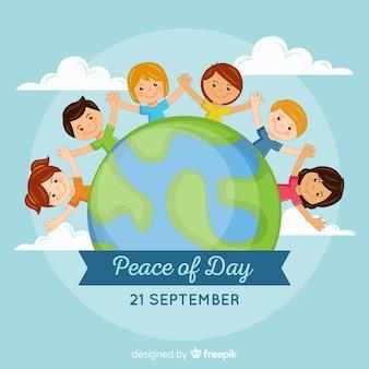 手を繋いでいる子供たちと手描きの平和の日