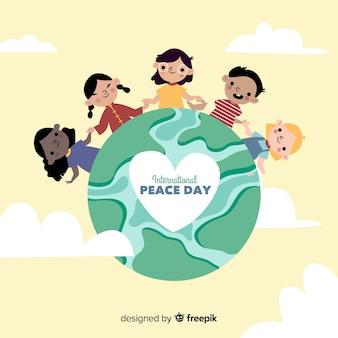 手を繋いでいる子供と手描きの平和の日